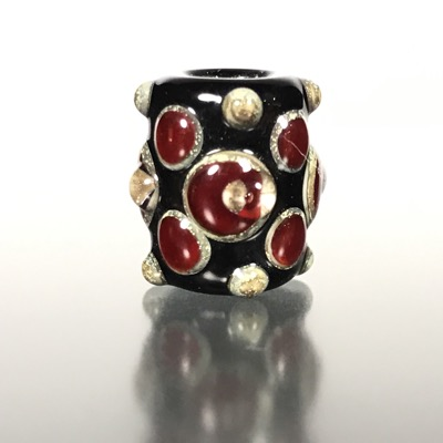 F118 - Small Red, Black, and Silvered Ivory Lampwork Focal Bead
