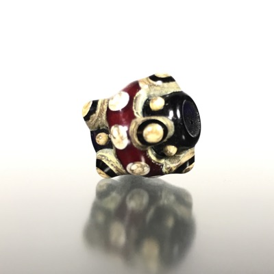 F119 - Red, Black, and Silvered Ivory Lampwork Bead